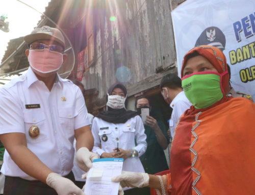 Penyerahan Bantuan Langsung Tunasi Dana Desa (BLT-DD) di Desa Karang Raja